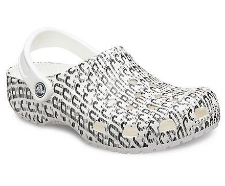 Crocs logo in black, sporty text on a white sandal