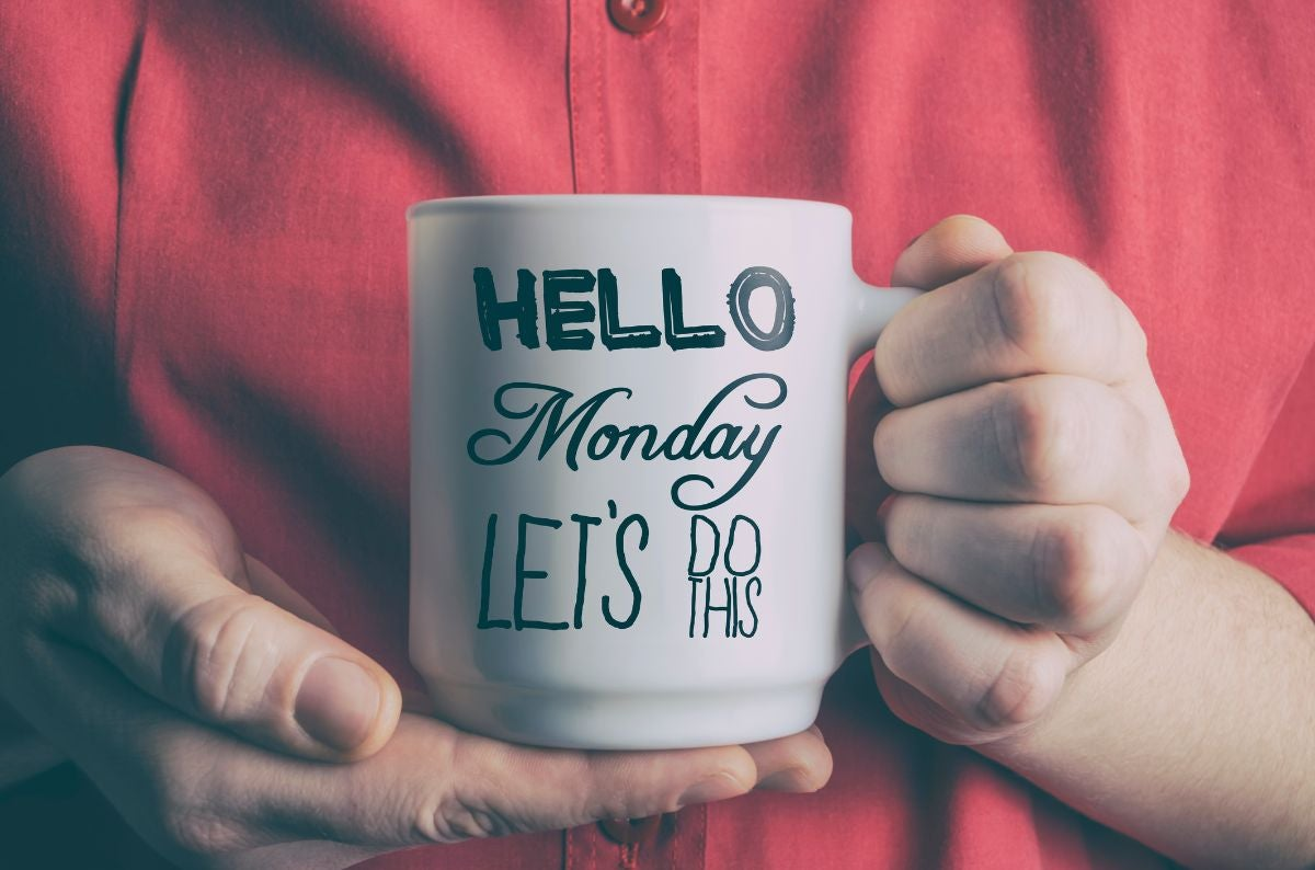"Someone holding a mug that says, ""Hello Monday let's do this"""