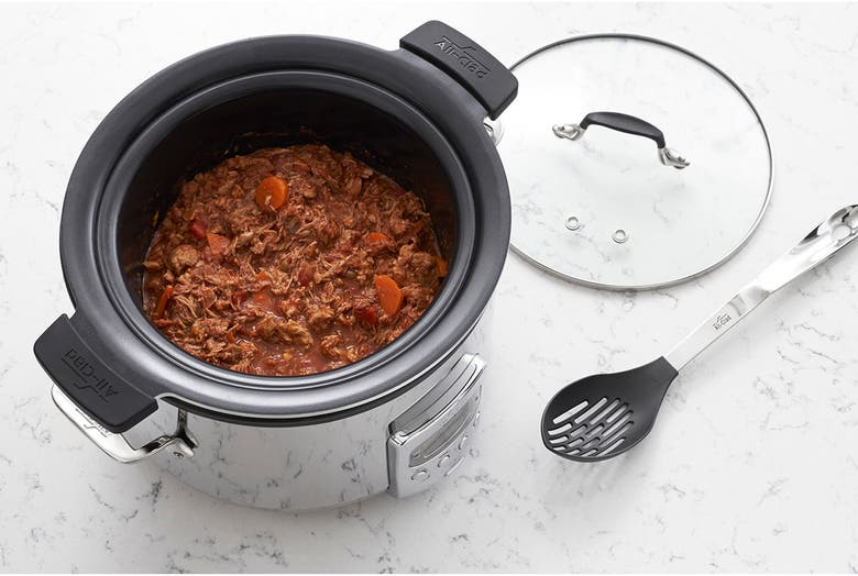 the silver circular slow cooker with a clear lid