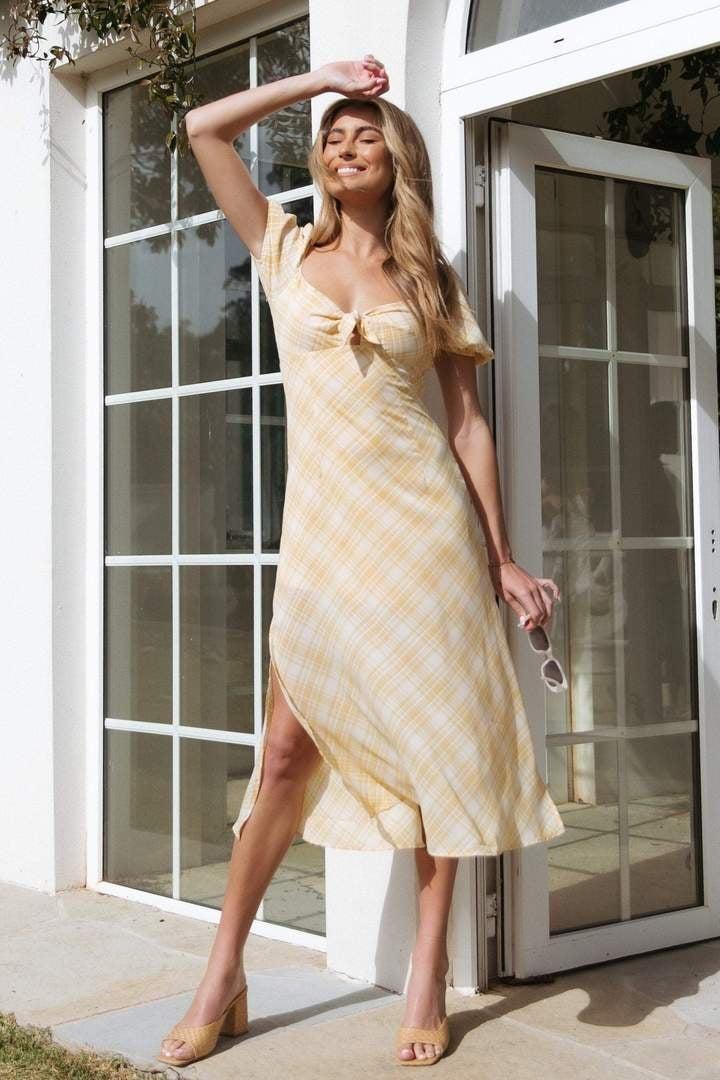 model wearing the dress with tan block heels