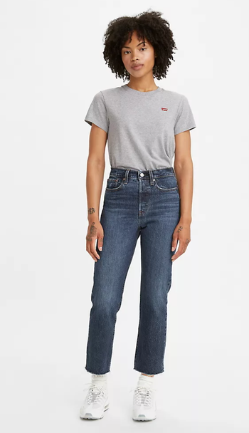 different model wearing the jeans in a darker wash