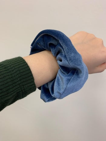 the scrunchie on reviewer's wrist
