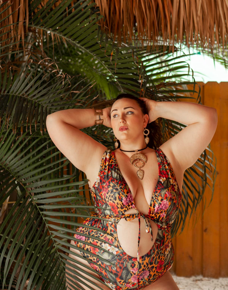 reviewer wearing one piece swimsuit with front cut-out in a botanical leopard print