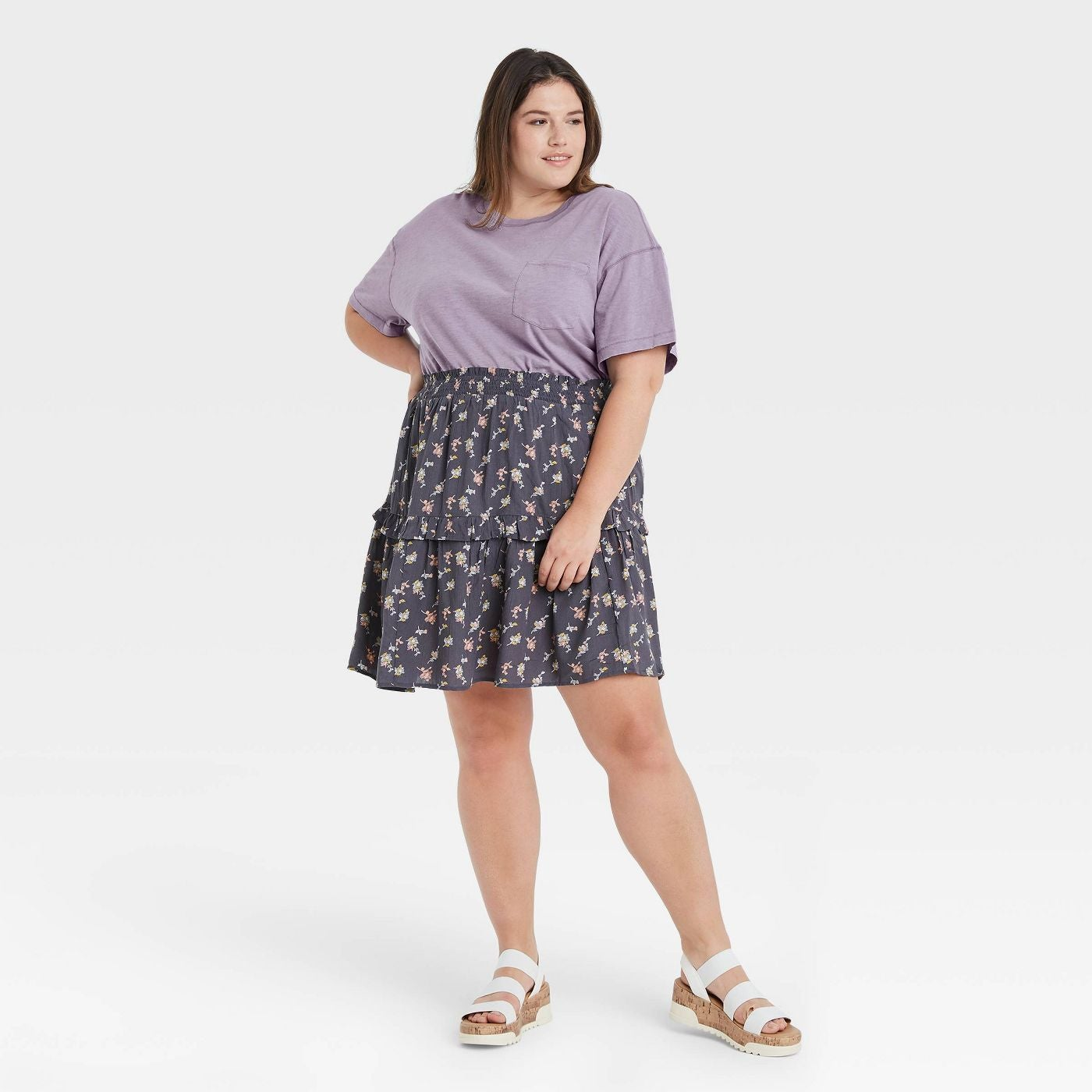Model wearing the tired floral skirt in dark grey