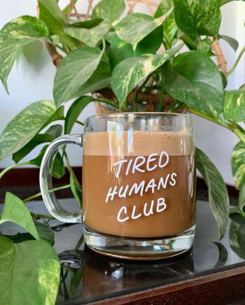 a glass mug that says