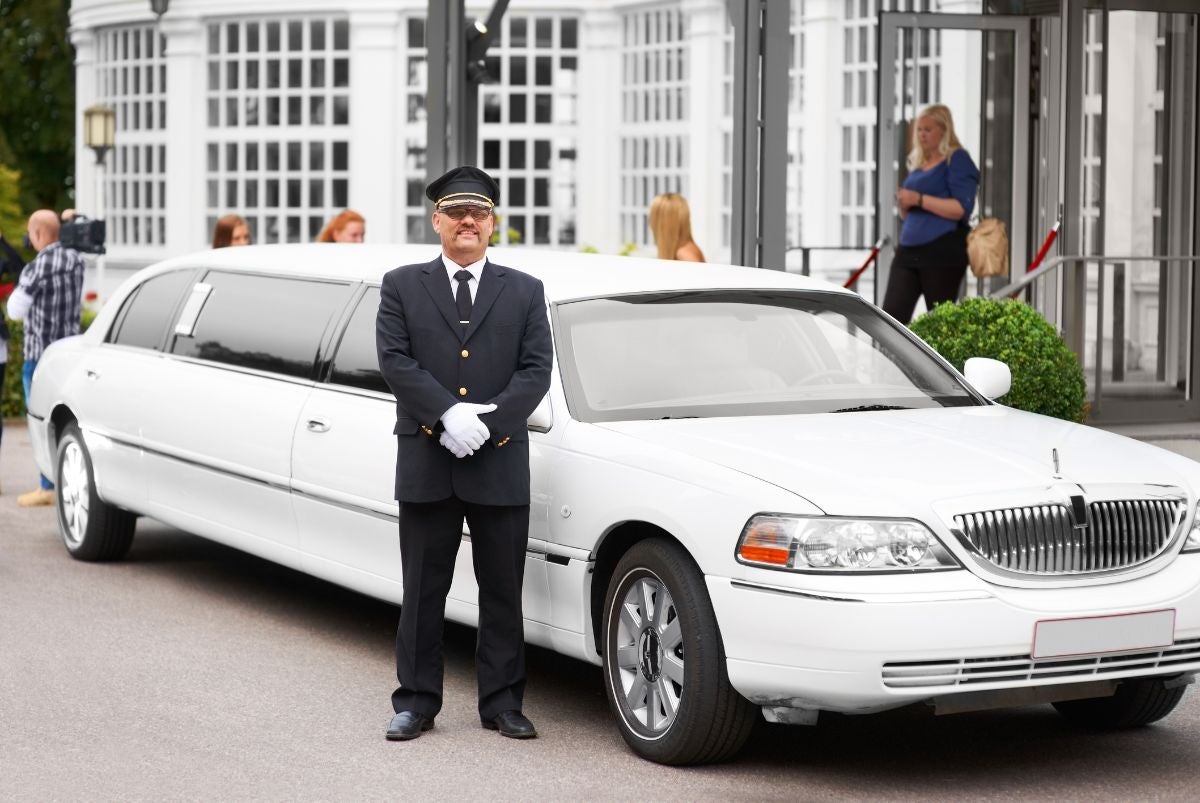 Limo driver professionally waiting for his clientele