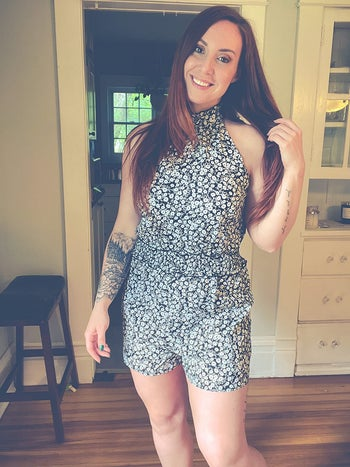 a different reviewer wearing the romper in a black and white floral print