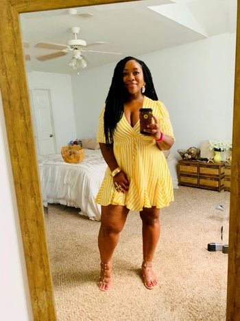 reviewer wearing the dress in yellow