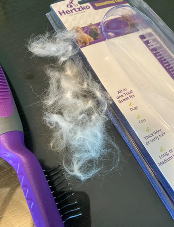 A customer review photo of all their dog's hair removed with the brush