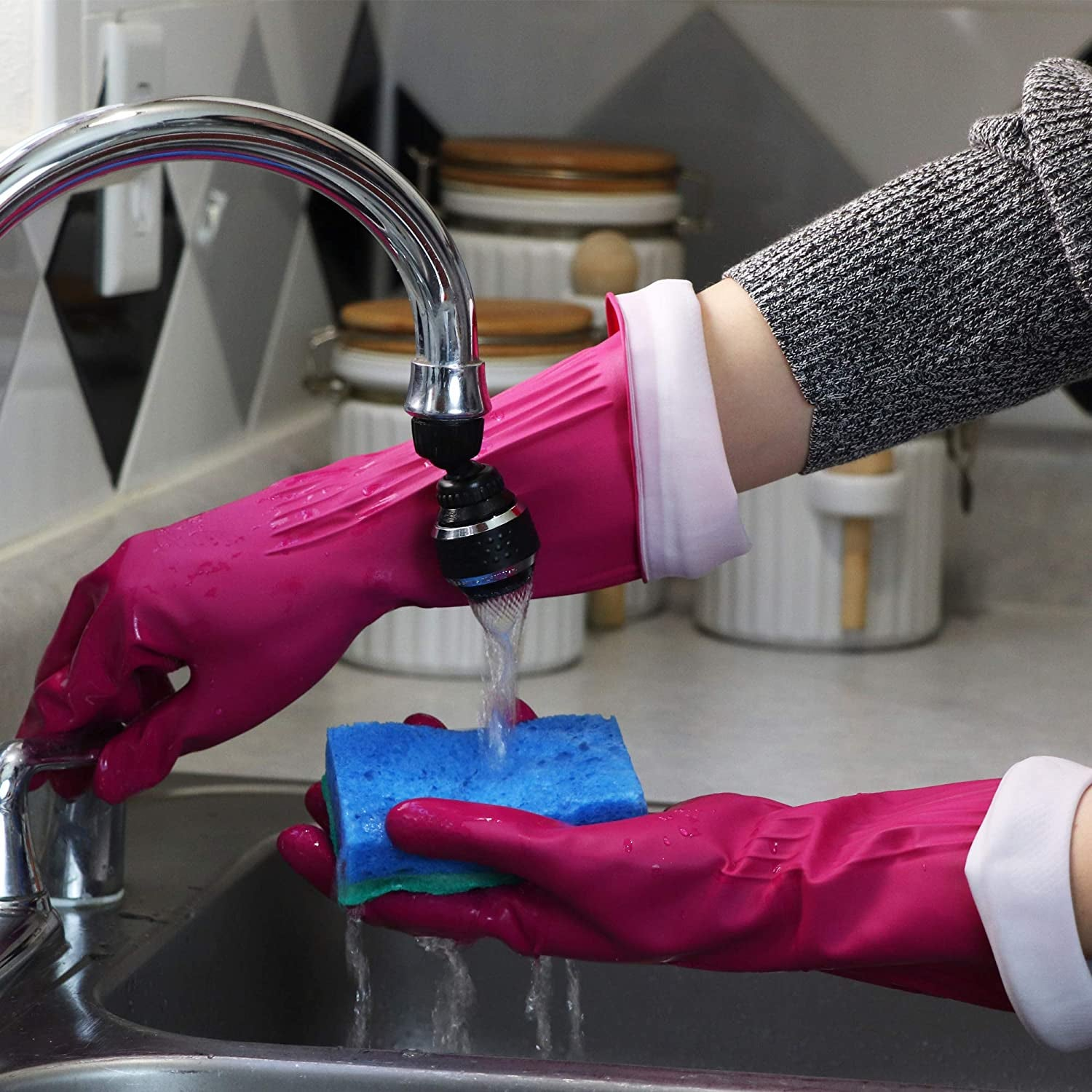 person wearing gloves while washing dishes