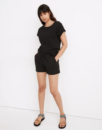 model wearing the shorts with a matching black t-shirt