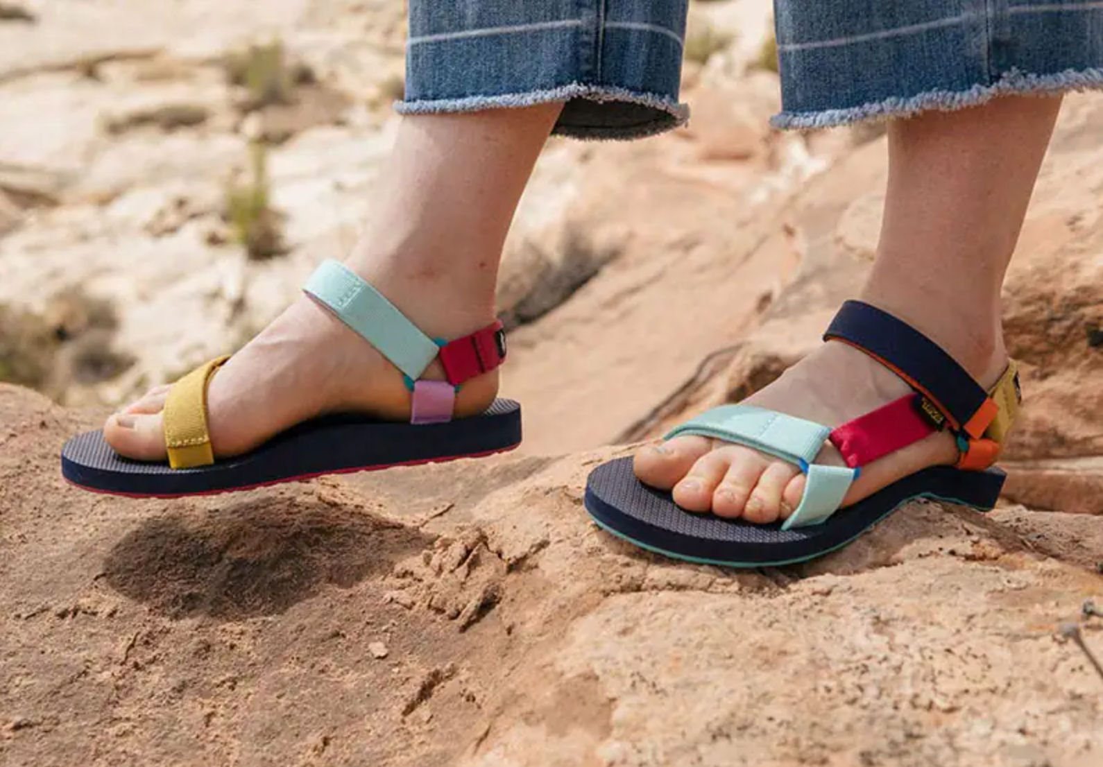 the sandals with multi-colored straps that are different on each shoe