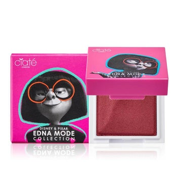 a pink square lip powder with edna mode on the front of the package