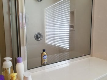 After photo of the same glass door looking much cleaner