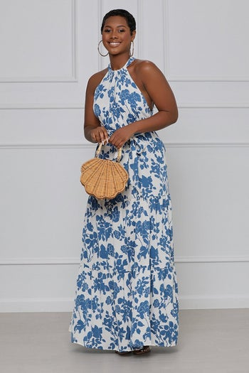 model in halter maxi with tiered skirt and blue flowers