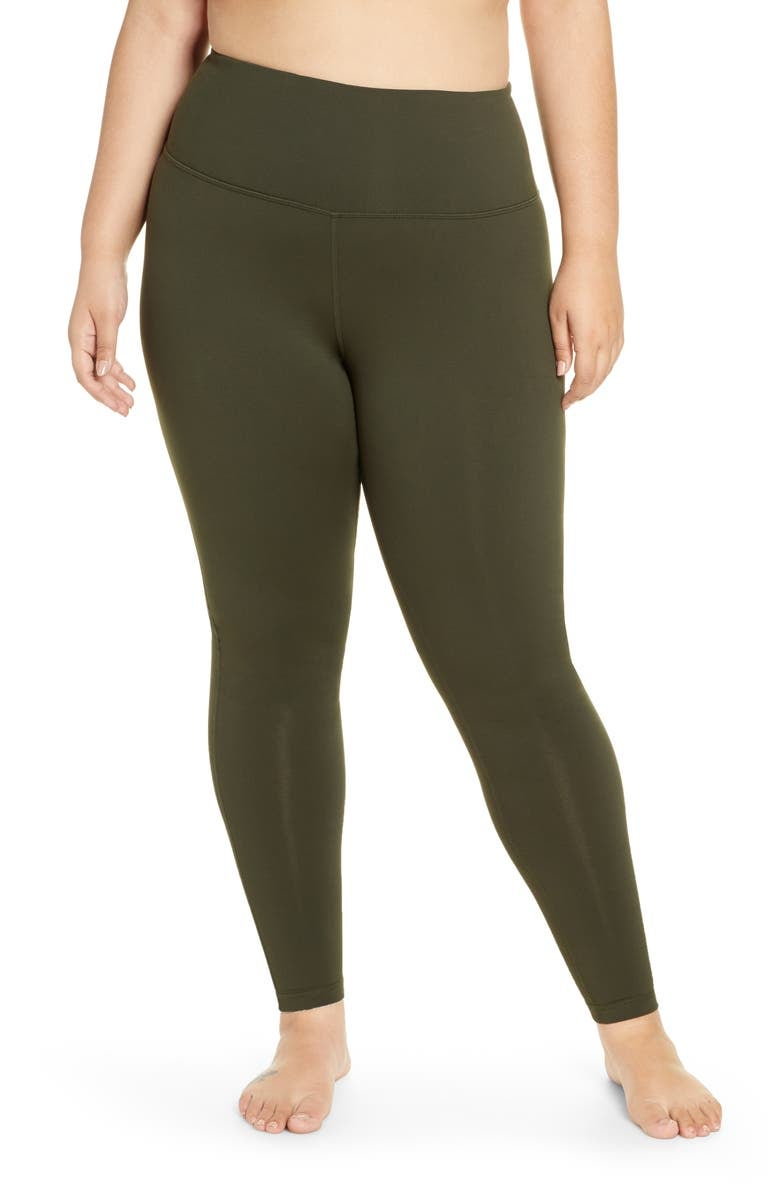 Model in a pair of olive green high waist leggings