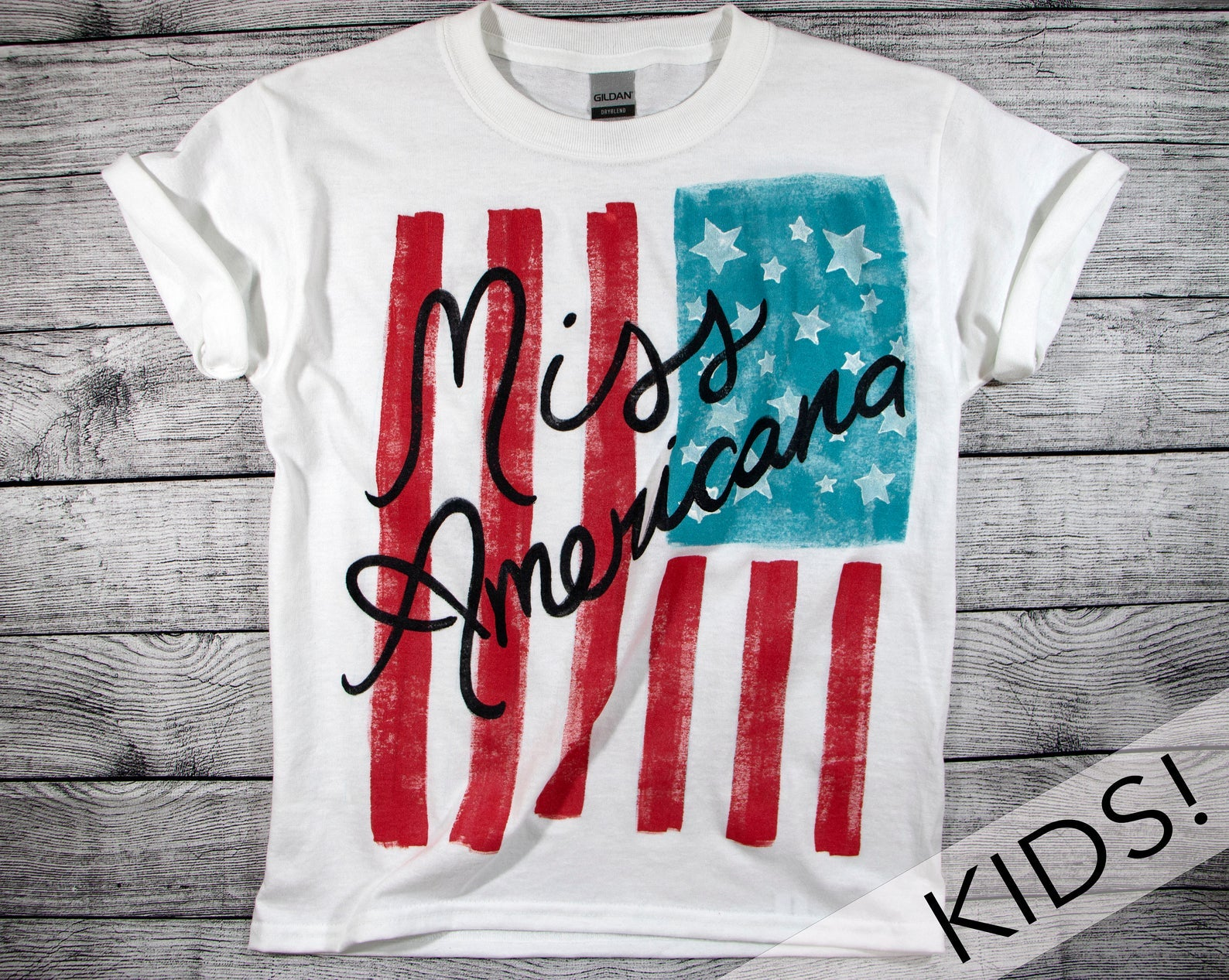 a white tee with an american flag on it and