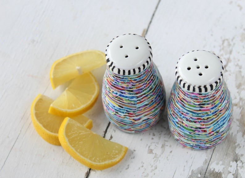 colorful ceramic salt and pepper shakers with white tops and striped trim