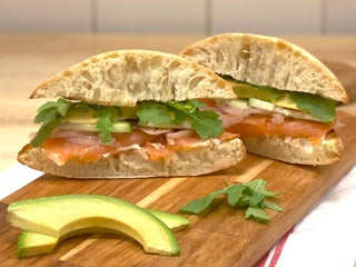 Cucumbers, red onions, arugula, and aioli on ciabatta bread
