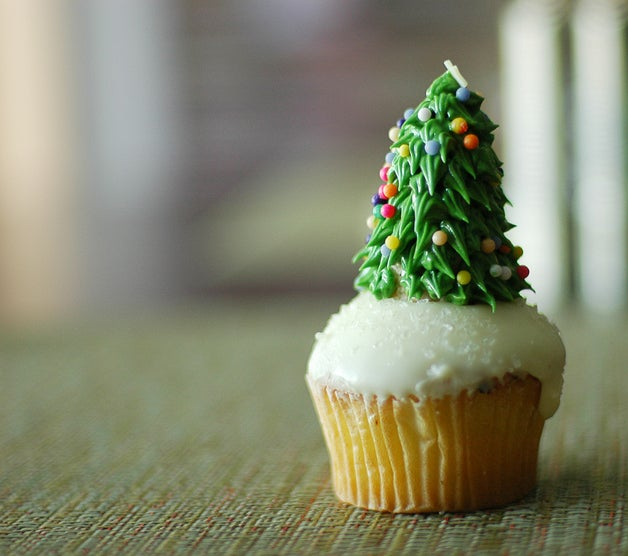 A cupcake with an icing Christmas tree on top