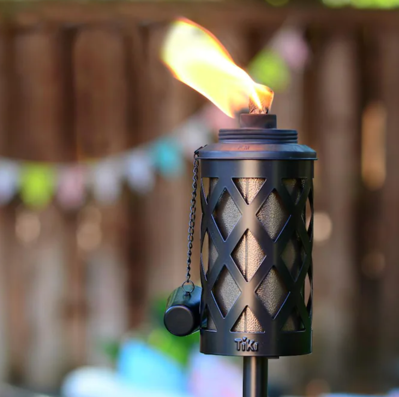 photo of the Tiki torch with citronella on fire