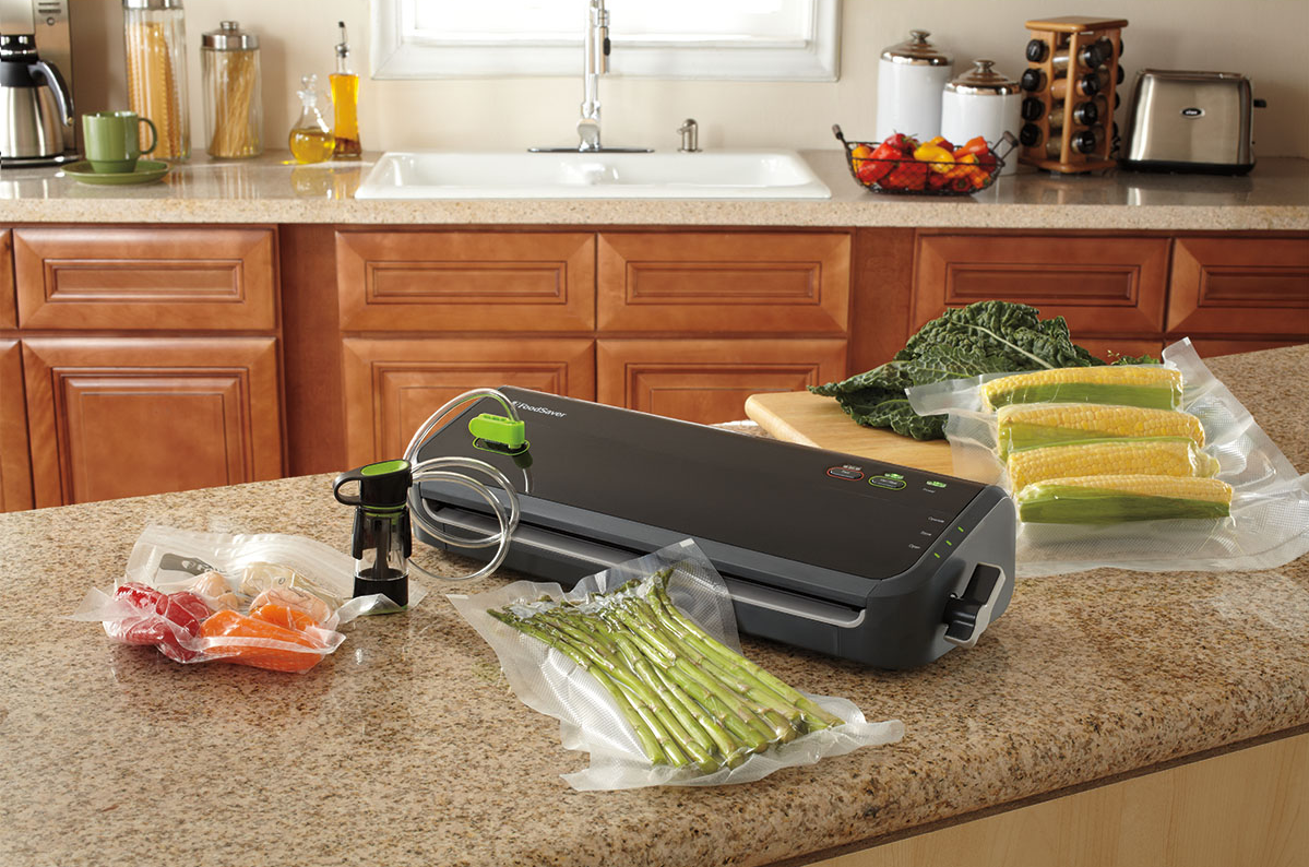A black vacuum sealer with a food that is sealed