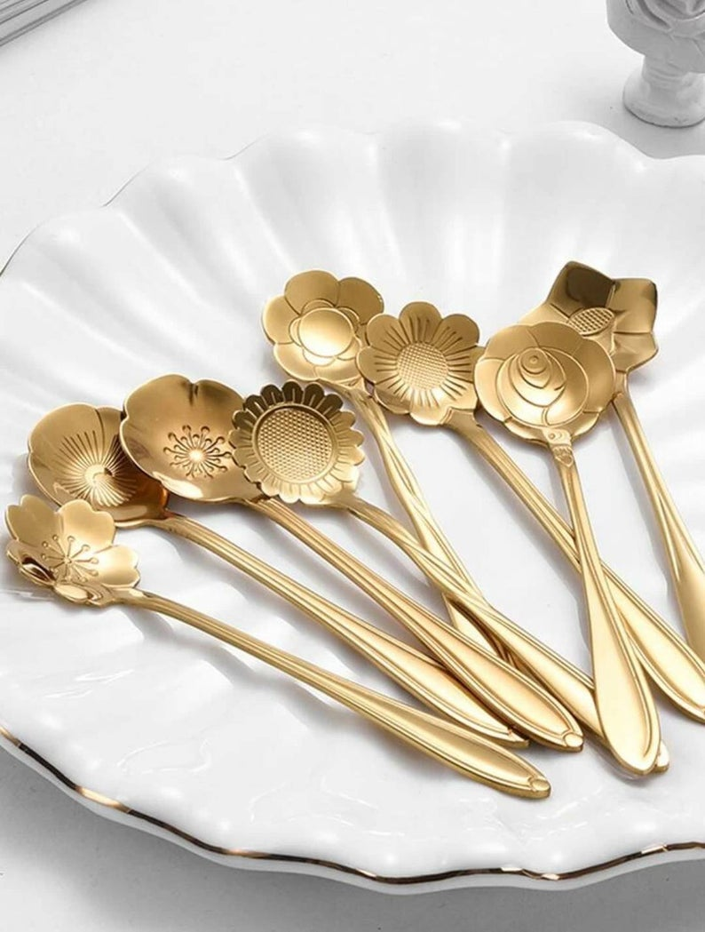 gold teaspoons with flower shaped scoops