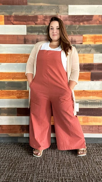 plus-size reviewer wearing the red clay version over a t-shirt and with a cardigan