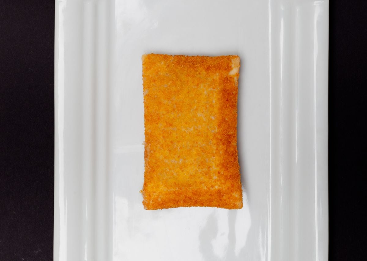 A fried pastry with cheese in the middle