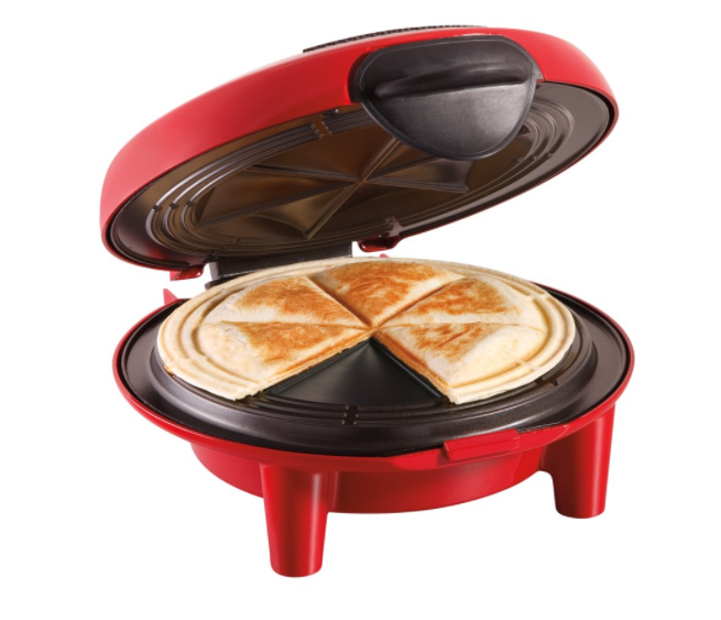 A red quesadilla maker with quesadillas in the middle