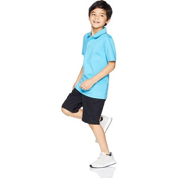 a child in a blue polo shirt
