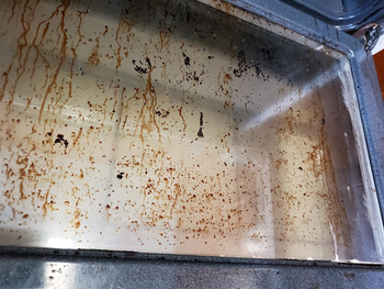 on left, dirty oven door with brown grease stains
