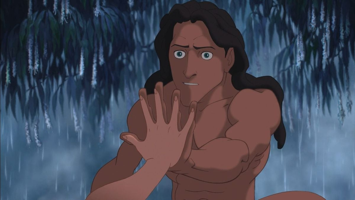 Tarzan reaches out his hand and Jane puts hers on his, as if comparing hand sizes