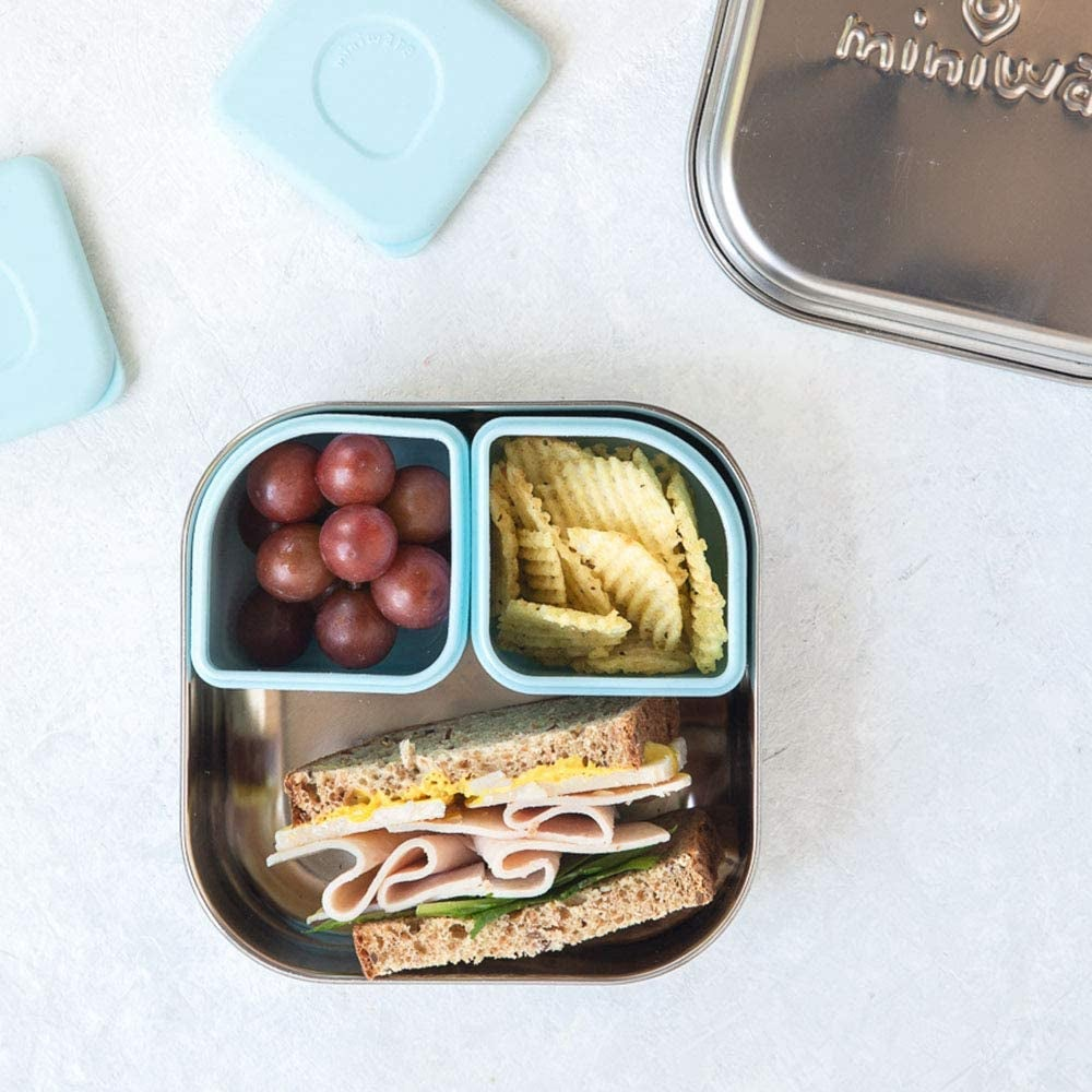 Light blue mental bento box with food inside