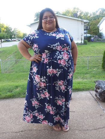 reviewer wearing a floral dress