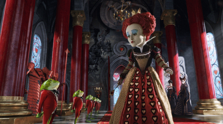 """Helena Bonham Carter looks at her army of frogs as the Queen of Hearts in """"Alice in Wonderland"""""""