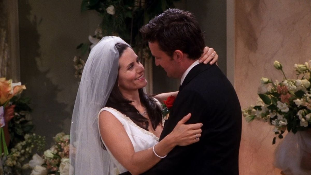 Chandler is holding Monica in his arms at the altar