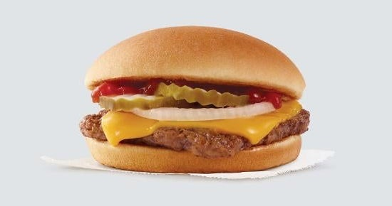 A cheeseburger with pickles, onions, ketchup, and mustard