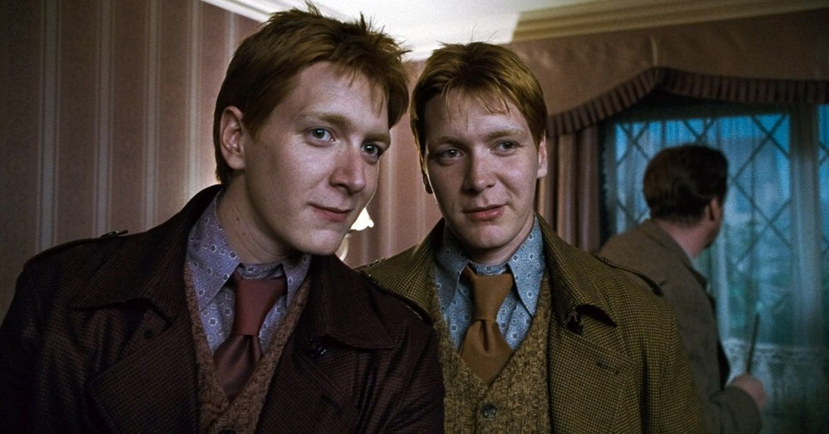 Fred and George smile