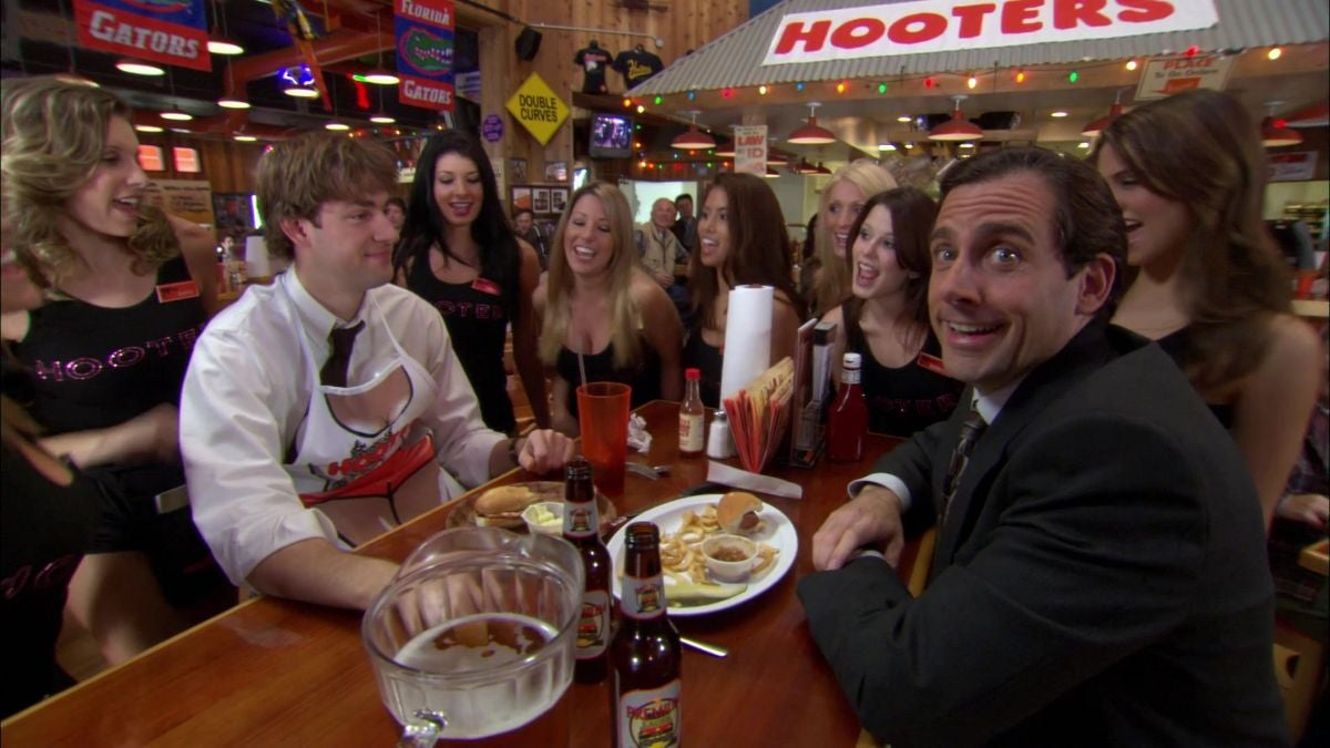 The team is sitting at a table, having lunch at Hooters