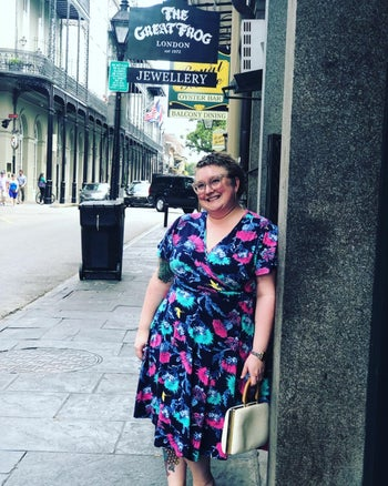 reviewer wearing the navy version with teal and pink flowers