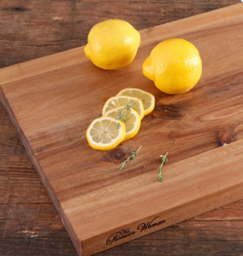 A cutting board with lemons, including lemons slices