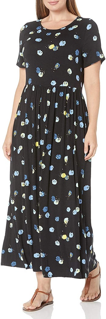 model in the black with yellow and blue flowers version