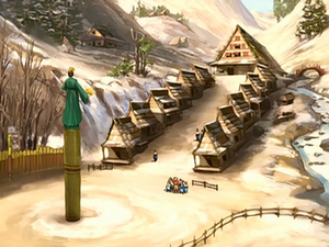 Village with a large statue of Avatar Kyoshi