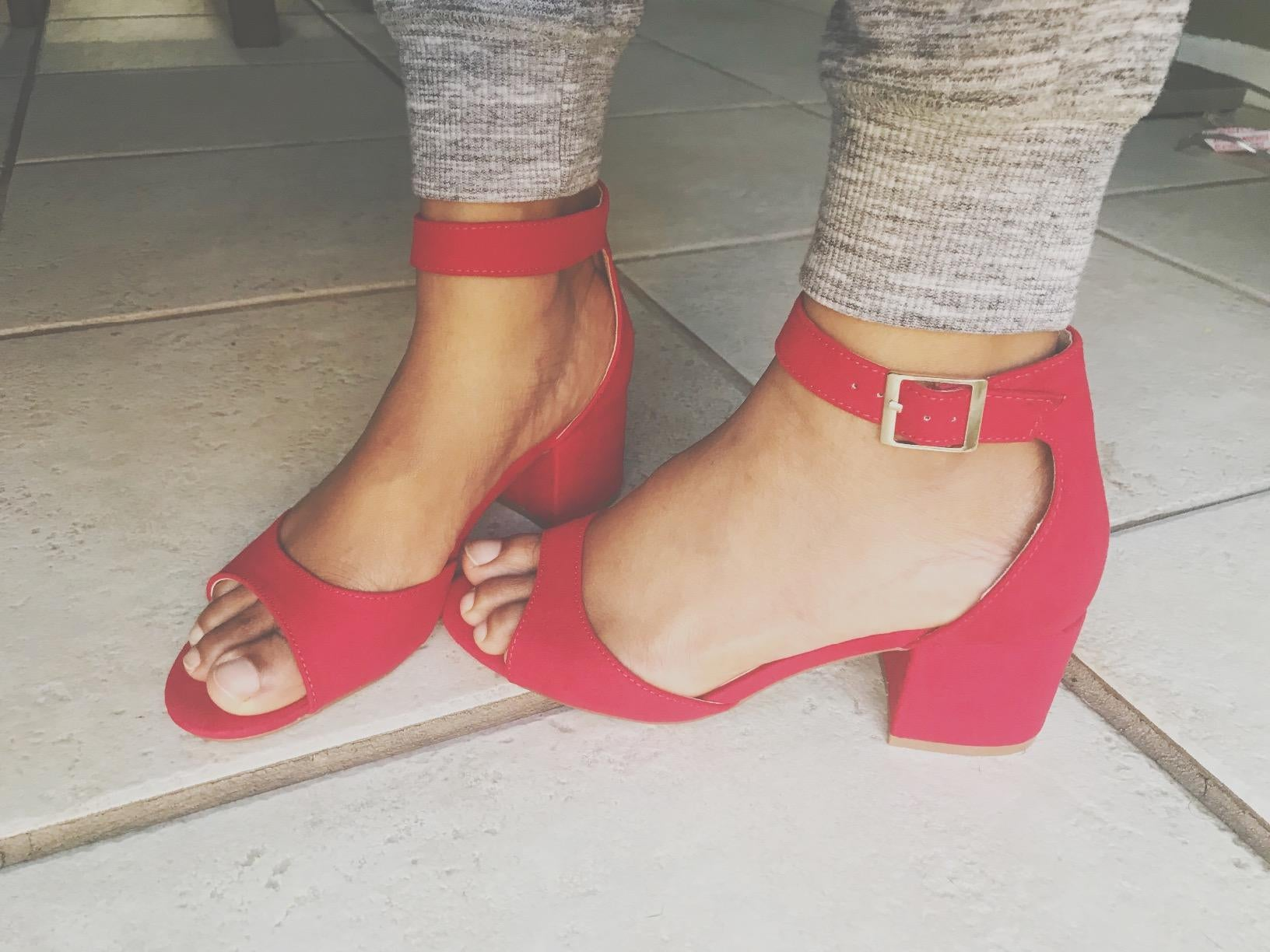 reviewer pic of the short heeled open-toe sandal in bright red