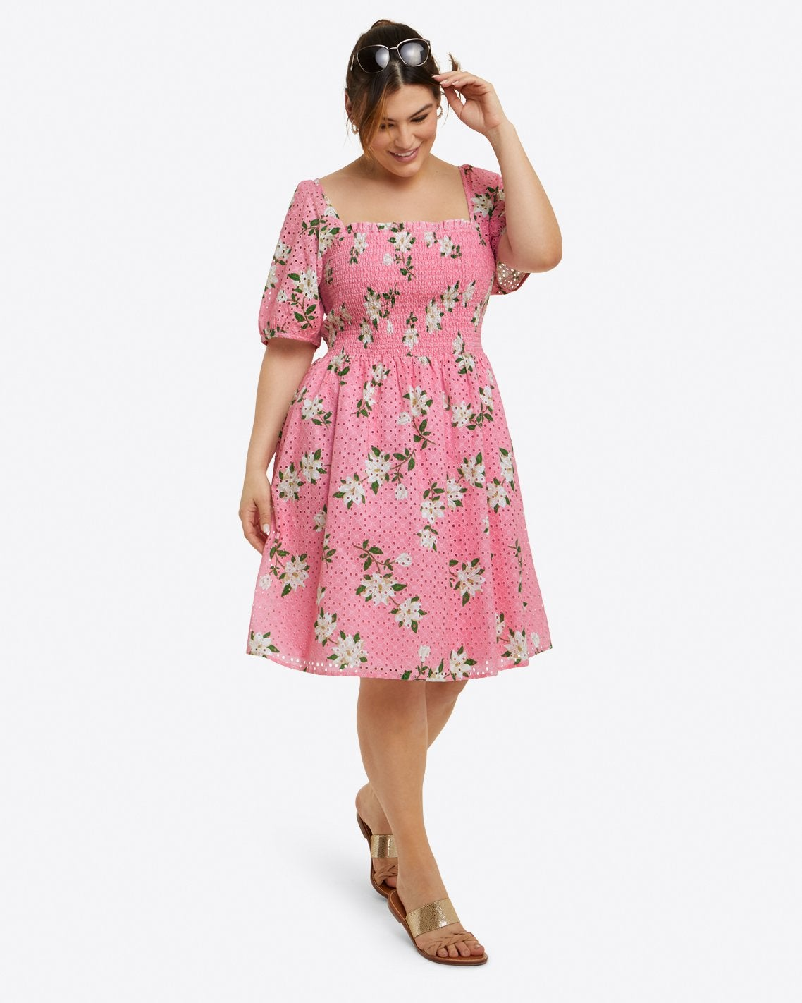 model in pink and white floral knee-length dress with elbow sleeves and a square neck