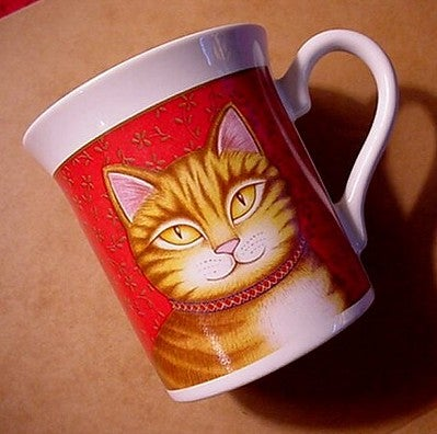 A mug with a ginger cat's face