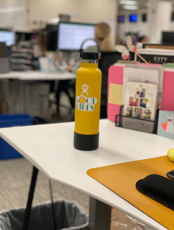reviewer photo of the water bottle on their desk in yellow