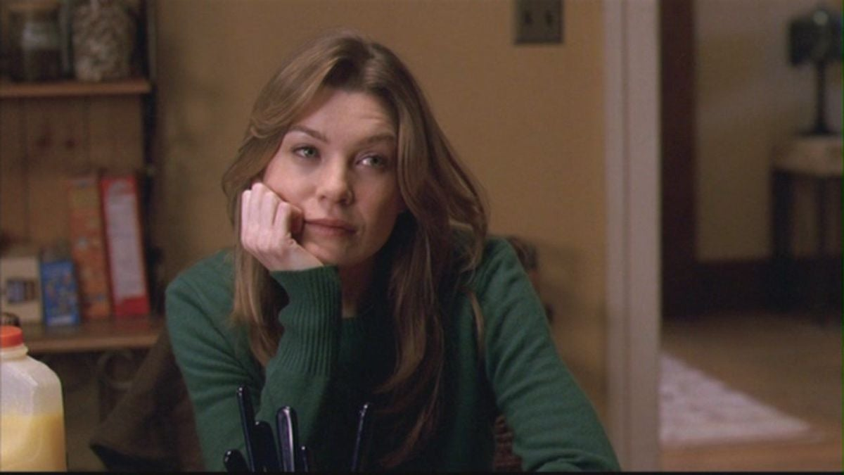 Meredith rests her head on her hand
