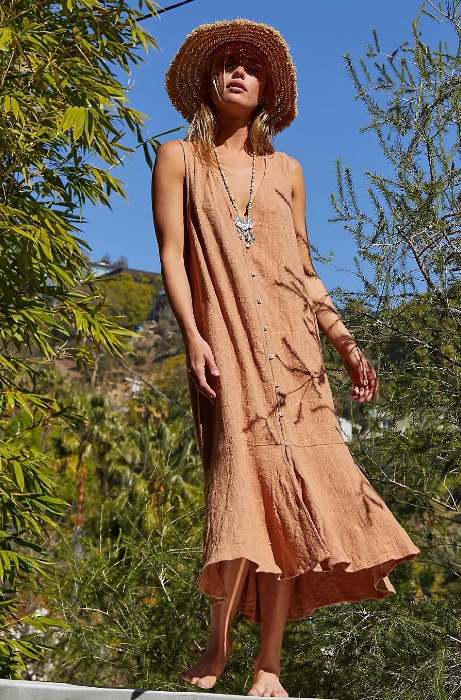 a model in a light tan vest midi tank dress